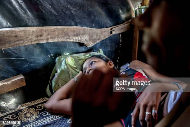 Rosa a 13yearold girl watch television after her day shift selling cashew seeds to tourists on Calle de la Calzada Nearly 20000 Nicaraguan children...
