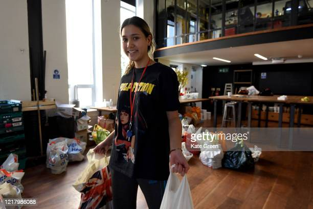 Rosa a volunteer from the Islington Covid19 Mutual Aid group with a food parcel for a weekly distribution to members of their community who are in...