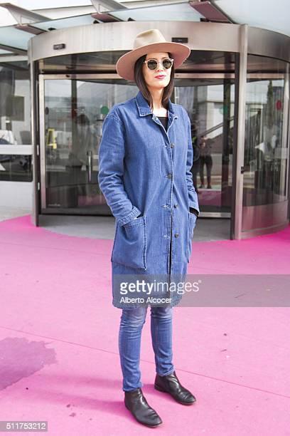 Rosa Copado wears Vintage shoes Diesel Jeans Mango Jacket Mango Jersey Vintage Sunglasses and La Doa hat during Mercedes Benz Fashion Week at Ifema...