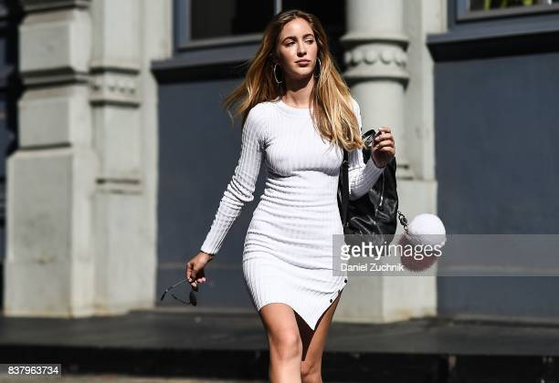 Rosa Crespo is seen in Soho wearing a Naked Wardrobe white dress and Laurencecchi backpack on August 22 2017 in New York City