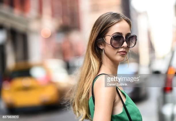 Rosa Crespo is seen in Soho wearing an Iorane green dress on August 22 2017 in New York City