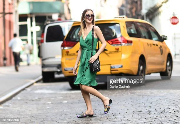 Rosa Crespo is seen in Soho wearing an Iorane green dress Saint Laurent bag and Etta Sabater shoes on August 22 2017 in New York City