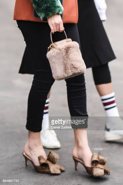 Rosa Crespo is seen with a pink fur bag at the Dion Lee show during New York Fashion Week Women's Fall/Winter 2017 on February 11 2017 in New York...