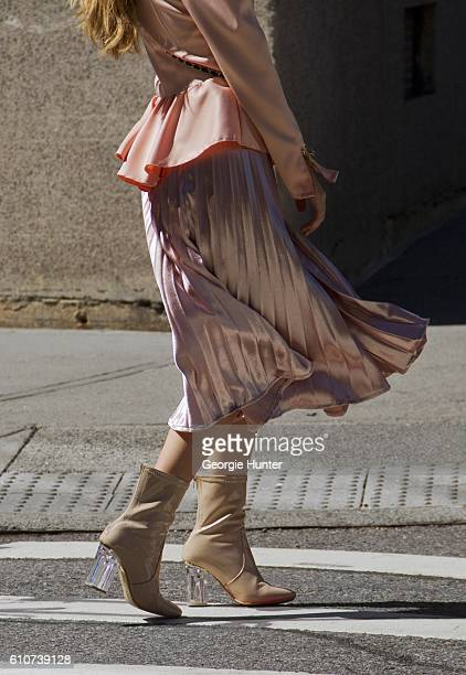 Rosa Crespo wearing silk bubblegum pink midi length high waisted El Corte Ingles lame skirt silk bubblegum pink puff shoulder jacket with ruffle...