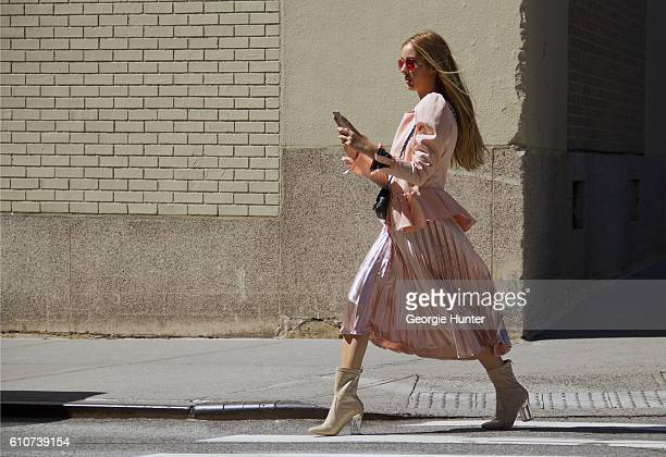 Rosa Crespo wearing silk bubblegum pink midi length high waisted El Corte Ingles lame skirt silk bubblegum pink puff shoulder jacket with ruffle...