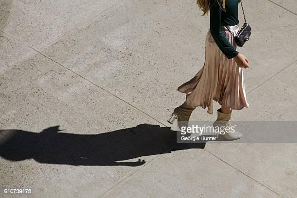 Rosa Crespo wearing silk bubblegum pink pleated midi length high waisted El Corte Ingles lame skirt green long sleeve Sandro Paris top with ruffle...