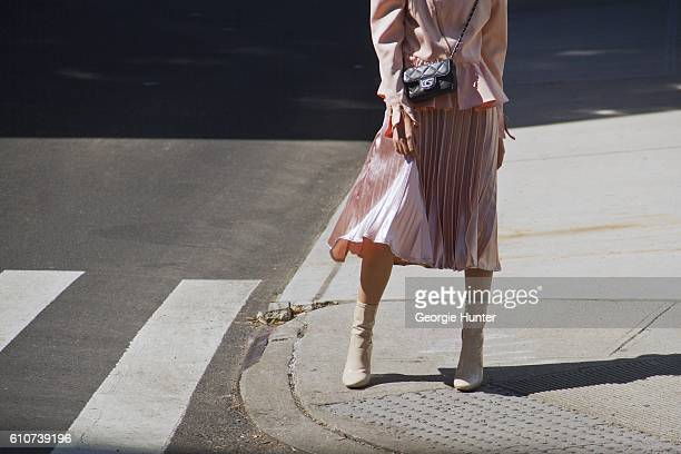 Rosa Crespo wearing silk bubblegum pink pleated midi length high waisted El Corte Ingles lame skirt silk bubblegum pink puff shoulder jacket with...