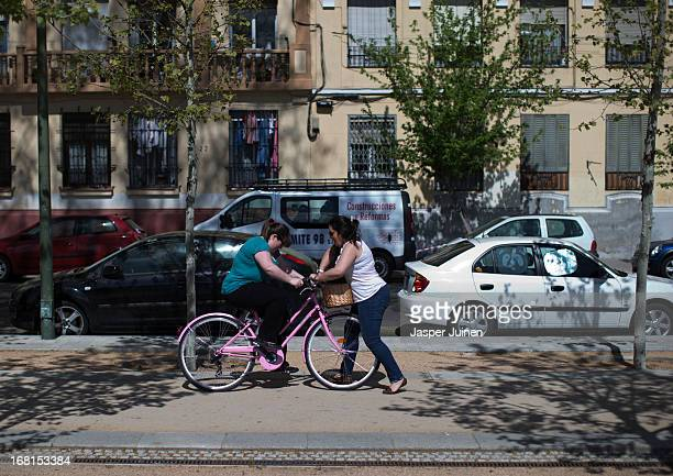 Rosa Gonzalez 21 yearsold from Granada helps Judit Herrera 27 yearsold from Madrid to learn to ride a bicycle a popular method of transport in the...