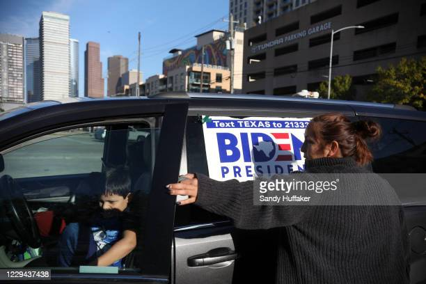 Rosa Gonzalez prepares to go vote at the Toyota Center to drive-thru vote on November 3, 2020 in Houston, Texas. After a record-breaking early voting...
