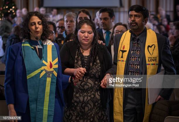 Rosa Gutierrez is escorted from a multifaith vigil and press conference at Cedar Lane Unitarian Universalist Church in Bethesda Maryland December 12...