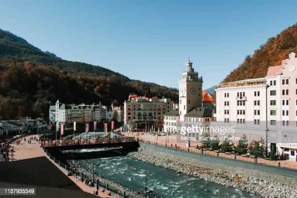 rosa khutor alpine resort by river in city - sochi stock pictures, royalty-free photos & images