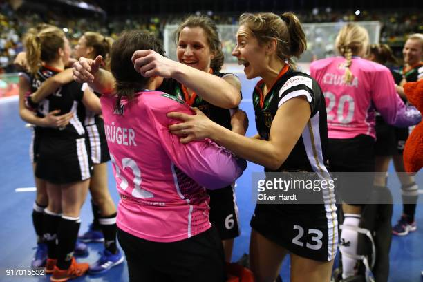 Rosa Kruger Luisa Steindorof and Marie Maevers Germany celebrate after the Women Gold Medal Indoor Hockey World Cup Berlin Final Day match between...