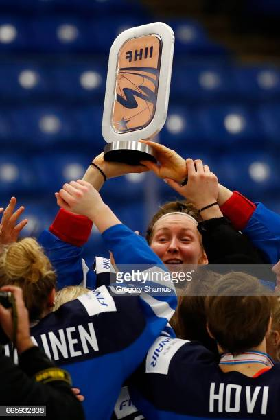 Rosa Lindstedt of Finland holds the trophy after a 8-0 win over Germany in the bronze medal game at the 2017 IIHF Woman's World Championships at USA...