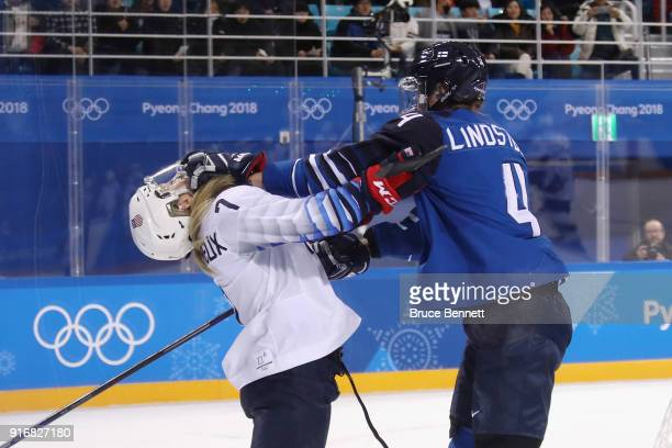Rosa Lindstedt of Finland shoves Monique LamoureuxMorando of the United States in the second period during the Women's Ice Hockey Preliminary Round...