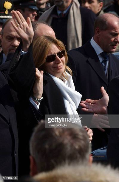 Rosa Maria Calipari waves to the people gathered in Santa Maria Degli Angeli Basilica at the end of the State funeral of her husband Italian...
