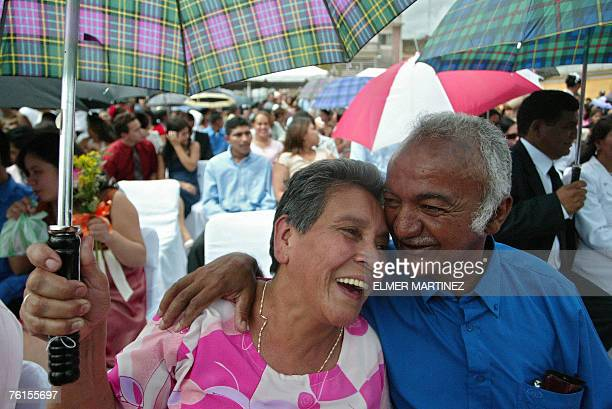 Rosa Maria Gomez and Selvin Pineda who have been living together for 50 years laugh during a mass wedding celebrated at Los Dolores square in front...