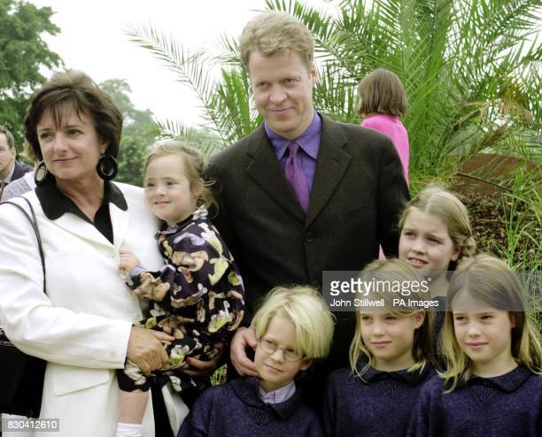Rosa Monckton holds her daughter Domenica alongside Earl Spencer and his children Louis Eliza Kitty and Amelia at the opening in London of the...