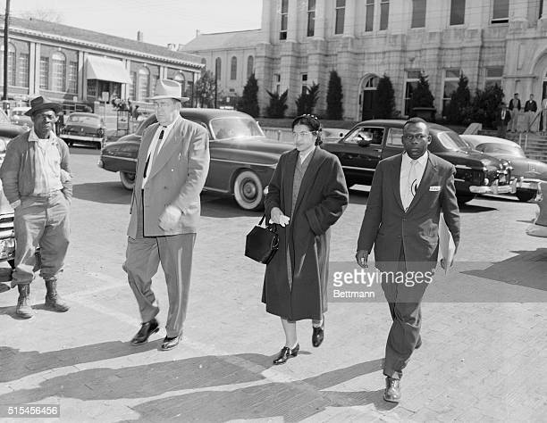 Rosa Parks accompanied by her attorney Charles D Langford and an unidentified deputy is on her way to jail arrested on charges of violating city...