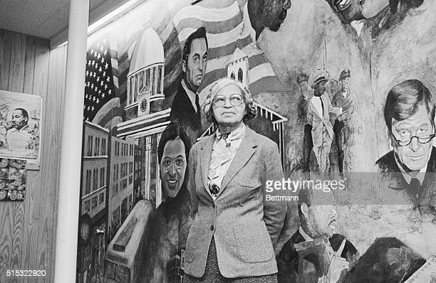 Rosa Parks poses with mural at the Dexter Avenue Martin Luther King Memorial Church which depicts the Civil Rights Movement after holding a news...