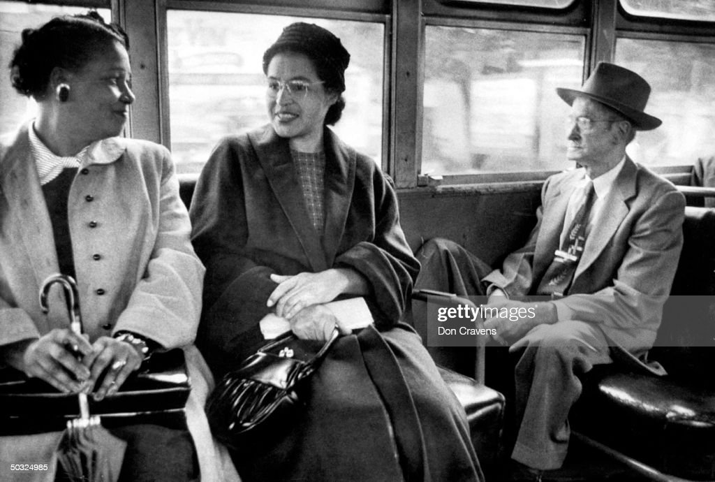 Rosa Parks (C) riding on newly integrated bus following Supreme Court ruling ending successful 381 day boycott of segregated buses. Boycott began when Parks was arrested for refusing to give up her seat to a white person.