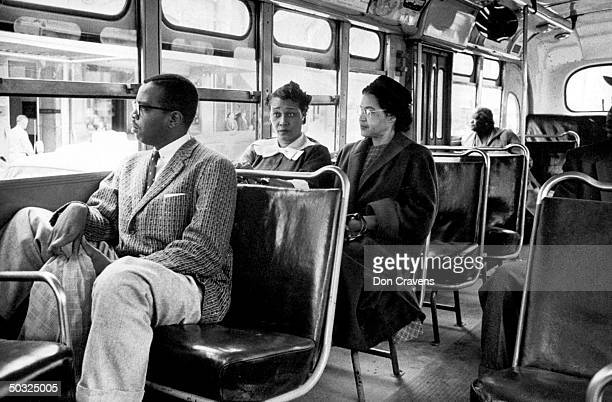 Rosa Parks riding on newly integrated bus following Supreme Court ruling ending successful 381 day boycott of segragated buses Boycott began when...