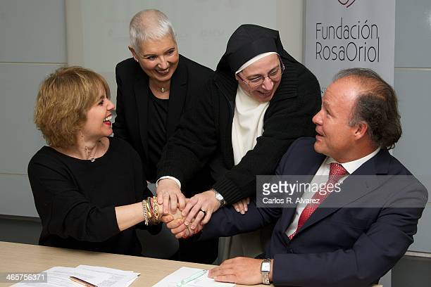 Rosa Tous, Rosa Oriol, Sor Lucia Caram and Ernesto Manrique pose for the photographers during the signing of cooperation between the Rosa Oriol...
