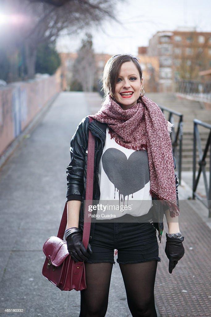 Rosa wears Nike trainers, Blanco trousers, Pull&Bear jacket and bershka handbag on March 3, 2015 in Madrid, Spain.