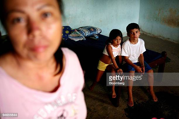 Rosalba Suarez with her granddaughter Leisy age 4 and her son Alexander age 9 stay in their room at Hacienda Napoles the favored recreation home of...