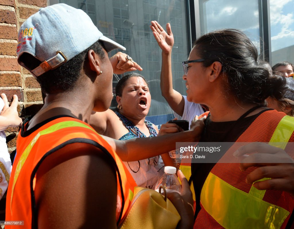 Rosalia Lugo yells out against African Americans at demonstrators during a rally on August 18, 2017 in Durham, North Carolina. The demonstrators rallied in reaction to white supremacists asking the city for a permit to gather.