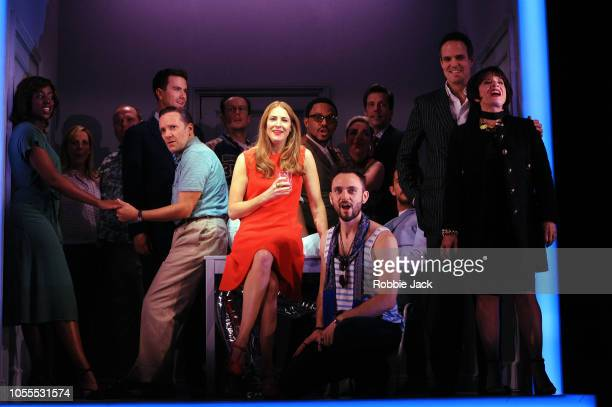 Rosalie Craig as Bobbie and Patti Lupone as Joanne with artists of the company in Stephen Sondheim's Company directed by Marianne Elliott at The...