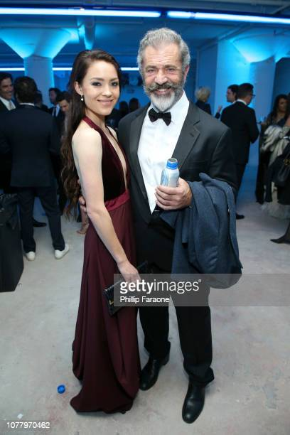 Rosalind Ross and Mel Gibson attend Michael Muller's HEAVEN presented by The Art of Elysium on January 5 2019 in Los Angeles California