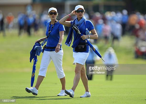 Rosalind Schwartzel and Tracy Goosen walk the course during the Day Two FourBall Matches of the 2011 Presidents Cup at Royal Melbourne Golf Course on...