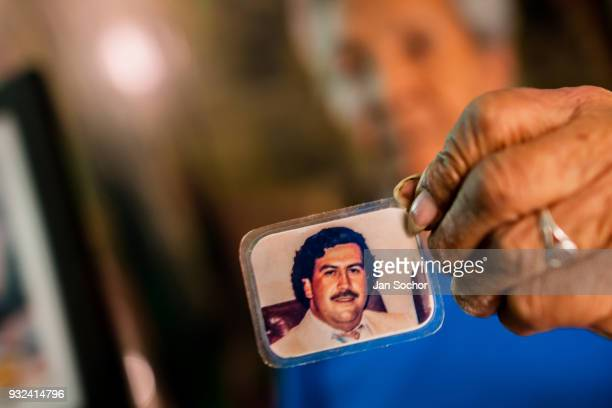 Rosalvina Vargas de Gallego one of the first inhabitants of the Pablo Escobar neighborhood shows a picture of Pablo Escobar kept in her wallet in...