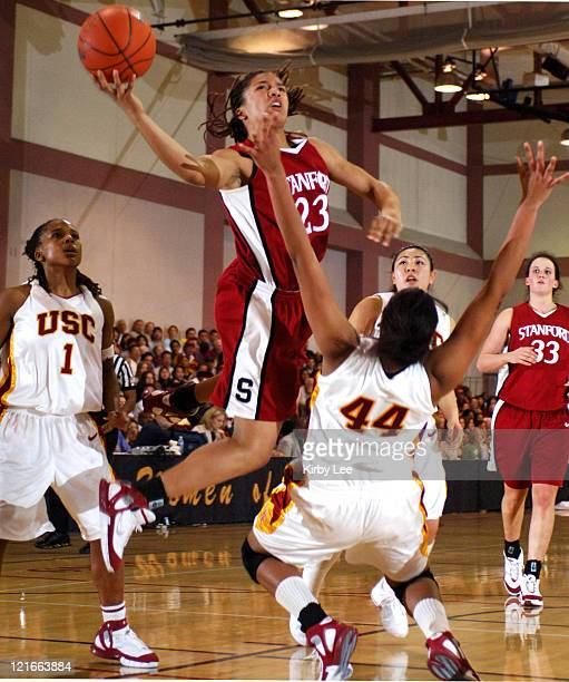 Rosalyn GoldOnwude of Stanford drives to the basket against Camille LeNoir Nadia Parker and Jamie Hagiya of USC during 7869 victory in Pacific10...