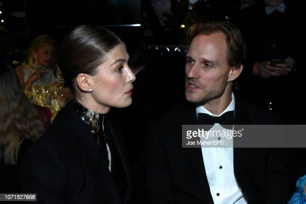 Rosamund Pike and a guest attend The Fashion Awards 2018 In Partnership With Swarovski at Royal Albert Hall on December 10 2018 in London England