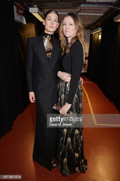 Rosamund Pike and Clare Waight Keller winner of British Designer of The Year Womenswear award for Givenchy pose backstage at The Fashion Awards 2018...