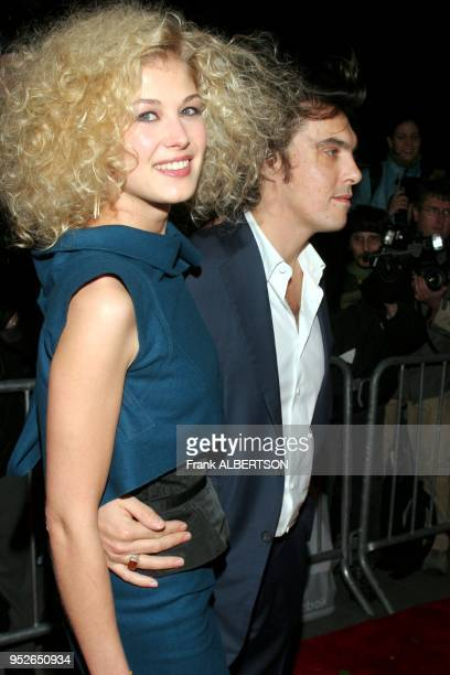 Rosamund Pike and director Joe Wright at the premiere of Pride and Prejudice New York NY Nov 10 2005 Photo by Frank Albertson