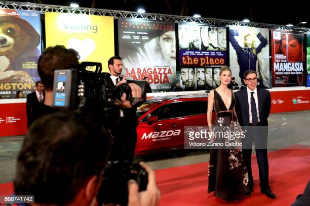 Rosamund Pike and director of the festival Antonio Monda walk a red carpet for 'Hostiles' during the 12th Rome Film Fest at Auditorium Parco Della...