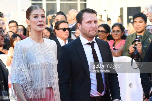Rosamund Pike and Matthew Heineman attend the 'A Private War' premiere during 2018 Toronto International Film Festival at Roy Thomson Hall on...