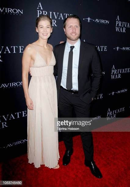 Rosamund Pike and Matthew Heineman attend the Los Angeles premiere of 'A Private War' at Samuel Goldwyn Theater on October 24 2018 in Beverly Hills...