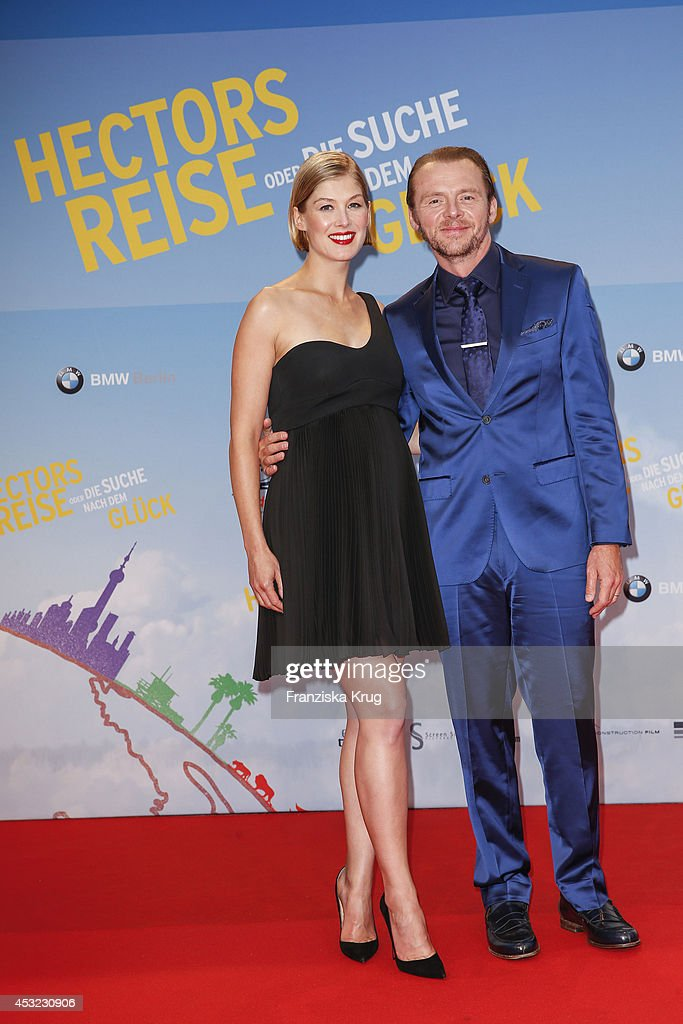 Rosamund Pike and Simon Pegg attend the premiere of the film 'Hector and the Search for Happiness' (German title: 'Hectors Reise') at Zoo Palast on August 05, 2014 in Berlin, Germany.