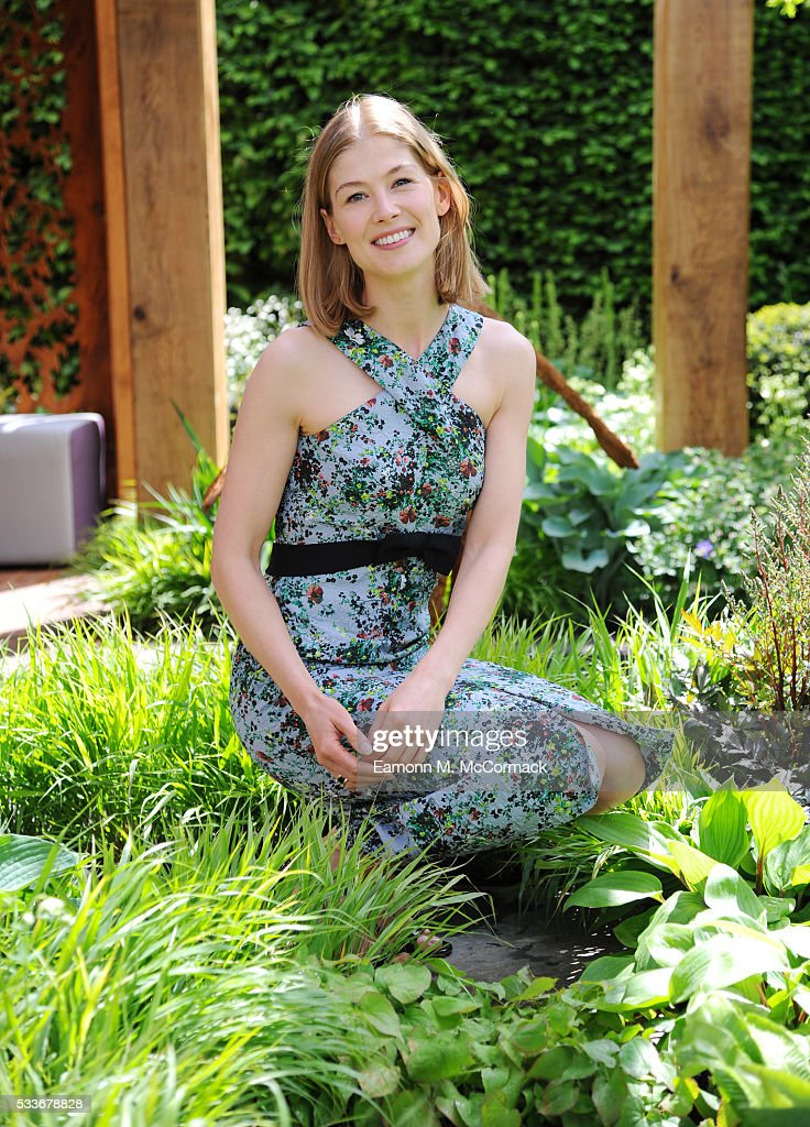 Rosamund Pike attends Chelsea Flower Show press day at Royal Hospital Chelsea on May 23, 2016 in London, England. The show, which has run annually since 1913 in the grounds of the Royal Hospital Chelsea, is open to the public from 24-28 May.