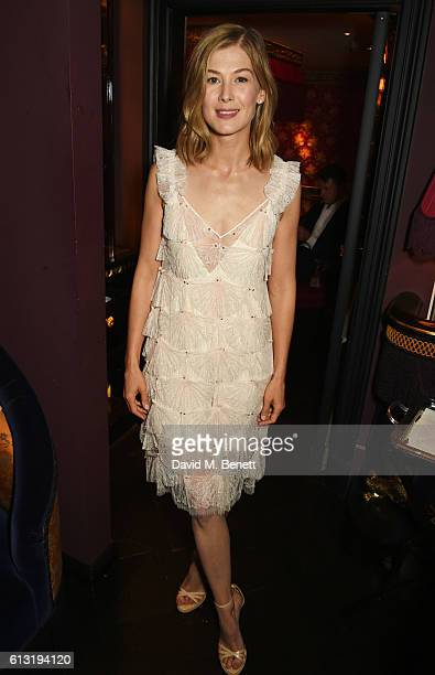 Rosamund Pike attends the Moncler 'Freeze For Frieze' Dinner Party at the Moncler Bond Street Boutique on October 7 2016 in London United Kingdom