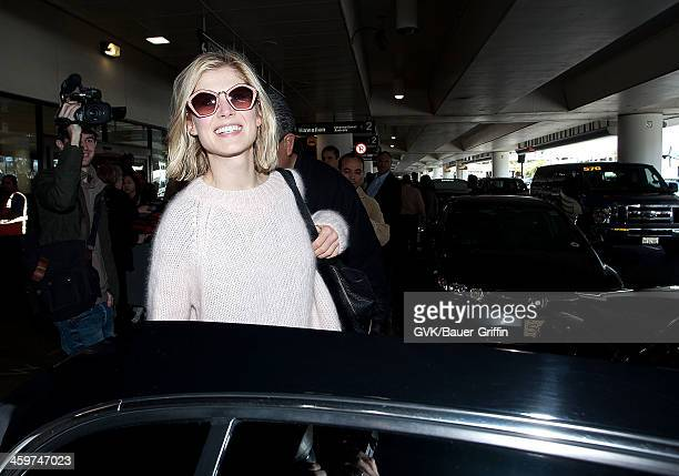 Rosamund Pike is seen at Los Angeles International Airport on March 09 2013 in Los Angeles California