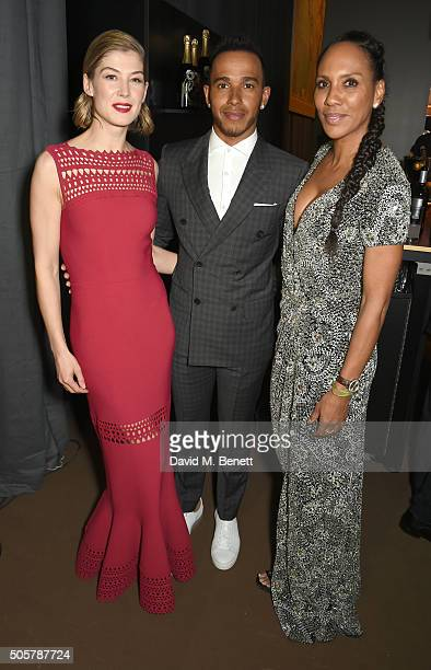 Rosamund Pike Lewis Hamilton and Barbara Becker attend the IWC 'Come Fly with us' Gala Dinner during the launch of the Pilot's Watches Novelties from...
