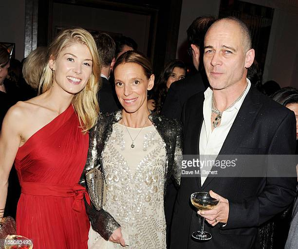 Rosamund Pike Tiphaine de Lussy and Dinos Chapman attend the Harper's Bazaar Women of the Year Awards 2012 in association with Estee Lauder Harrods...