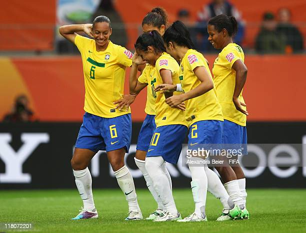 Rosana and Marta of Brazil celebrate their team's second goal together with teammates during the FIFA Women's World Cup 2011 group D match between...