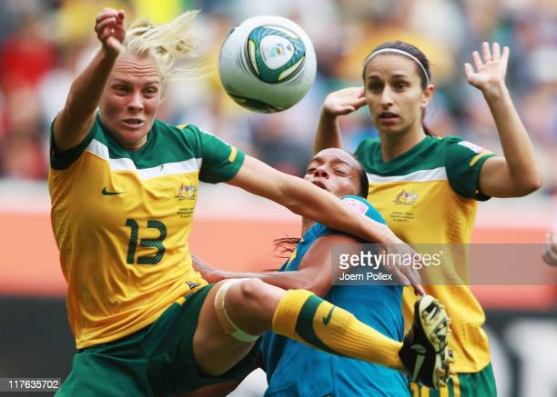 Rosana of Brazil and Tameka Butt of Australia battle for the ball during the FIFA Women's World Cup 2011 Group D match between Brazil and Australia...