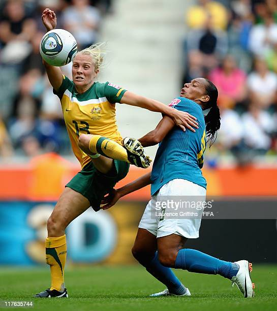 Rosana of Brazil beats Tameka Butt of Australia on her way to scoring the opening goal during the FIFA Women's World Cup 2011 Group D match between...