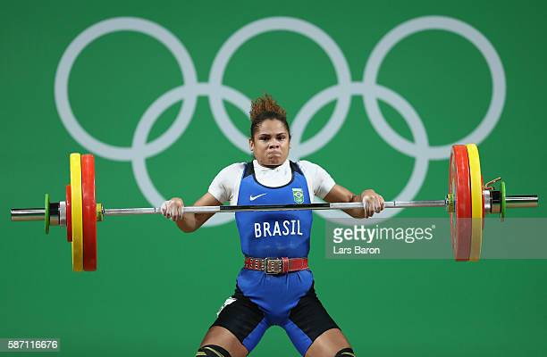 Rosane Dos Reis Santos of Brazil competes during the Women's 53kg Group A weightlifting contest on Day 2 of the Rio 2016 Olympic Games at Riocentro...
